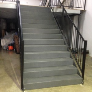 Steel stairs supplied on a mezzanine floor